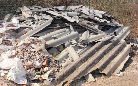 31180816 - asbestos waste dumped on open land